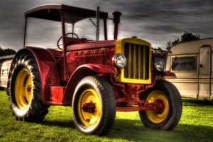 Canva---Red-and-Yellow-Tractor-Illustration
